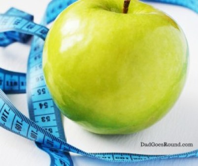 Image of an apple and tape measure