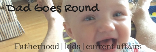 "Image of a smiling baby with text ""Dad Goes Round - Fatherhood, Kids, Current Affairs"""