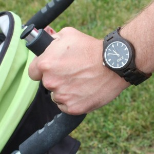 Image of a man wearing a Jord wooden watch and pushing a stroller