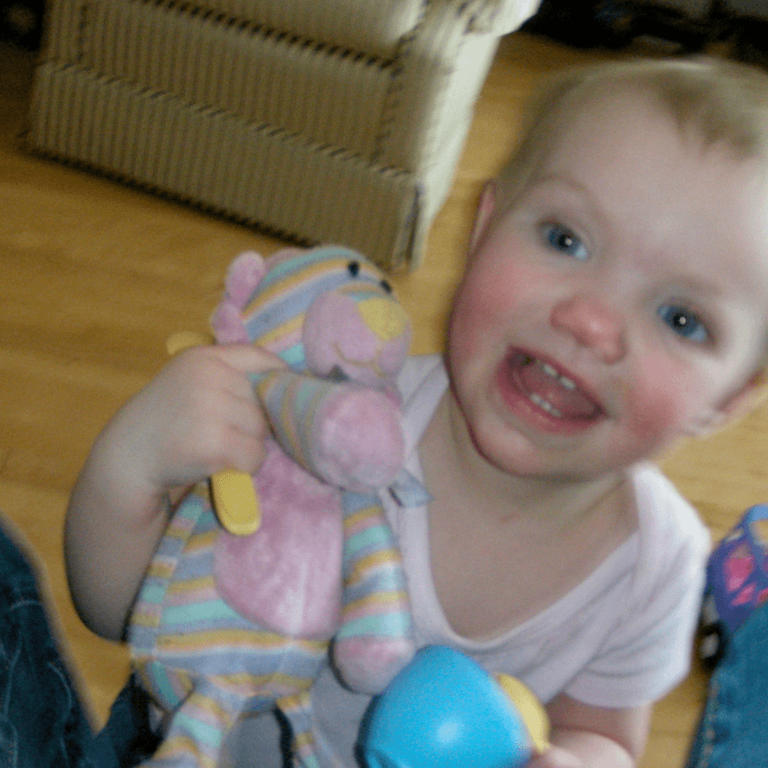 Image of a girl and her favourite striped pink lion