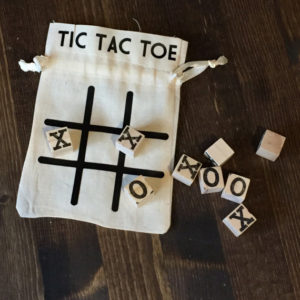 image of a wood tic tac toe game