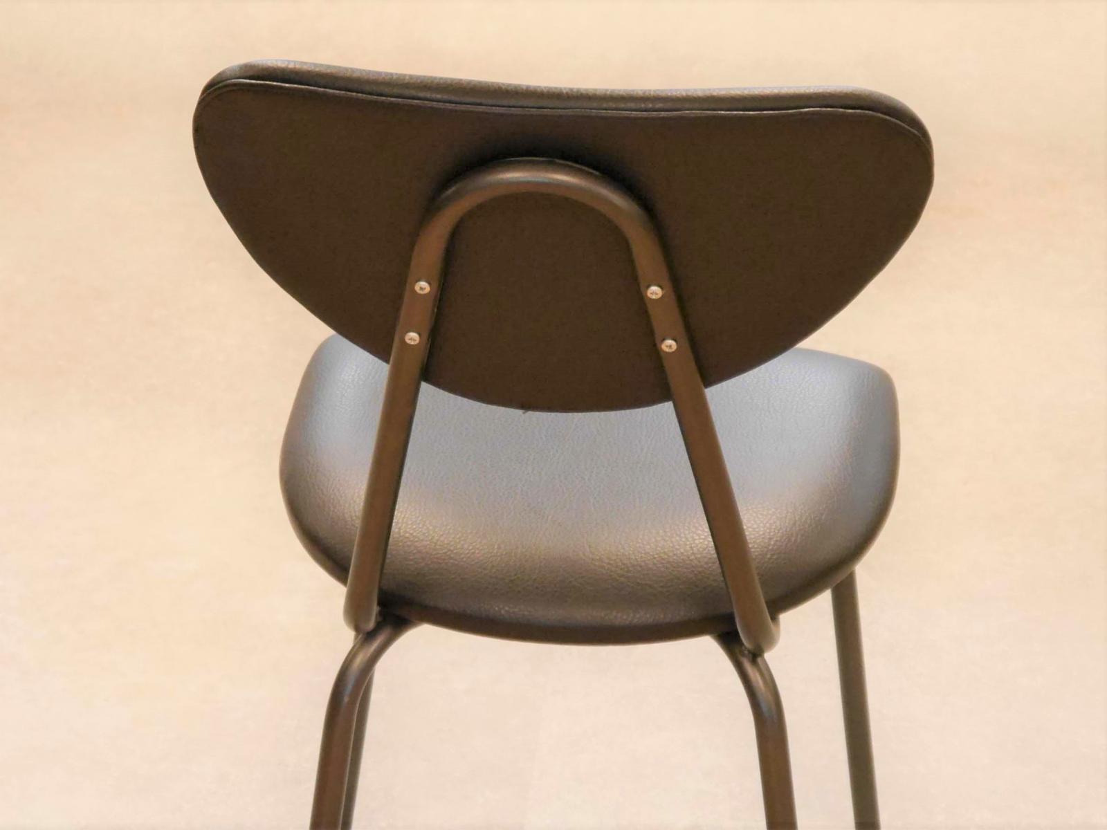 Parte trasera respaldo tapizado silla colegio