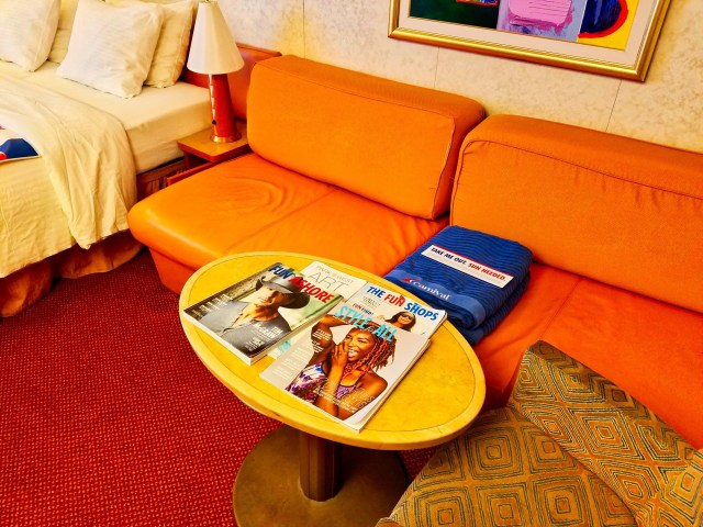 Carnival Liberty Balcony Stateroom - Couch and Table