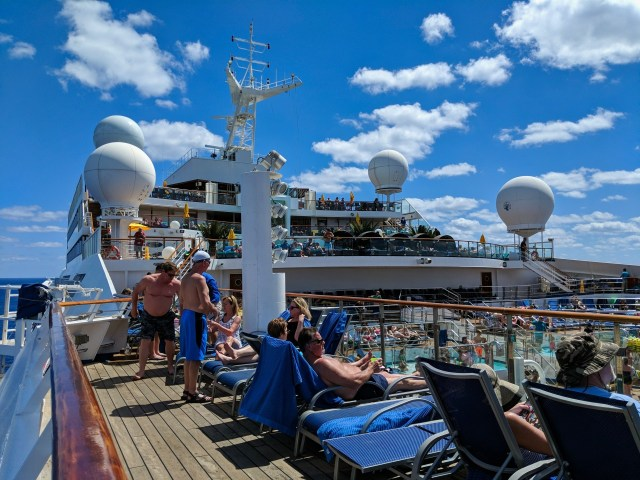 Busy deck on a sunny day at sea on board the Carnival Sunshine Ship