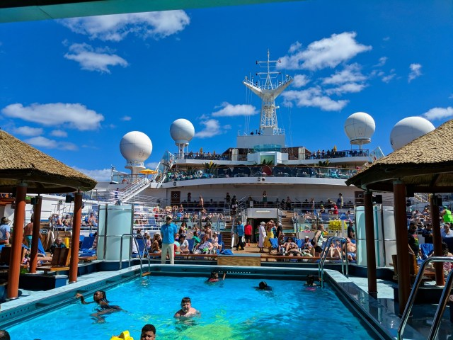 Active pool on a partly cloudy day at sea on the Carnival Sunshine Ship