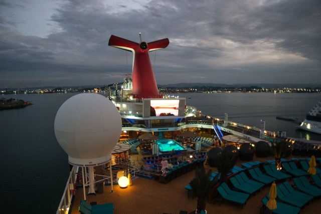 Looking over Carnival Sunshine from Serenity Deck at night in San Juan