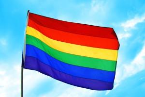 Gleichstellung der Ehe für Homosexuelle. a rainbow flag on a sky blue