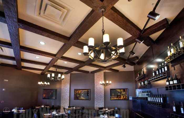 Farmhouse Design With Faux Wood Beams & Faux Stone Panels
