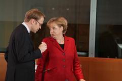 Jens Weidmann e Angela Merkel
