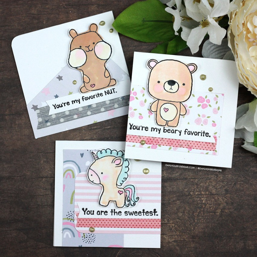 Sharing a simple card idea for little Valenties with a tutorial & quick video. So easy to recreate. The images are from the Tiny Bear, Tiny Unicorn and Tiny Squirrel Unity Stamp Company stamp sets. More inspiration on dahlhouse-designs.com. #cardmakingideas #cardmaker #cardmakingideas #cardinspiration #simplecards #rubberstamps #dahlhousedesigns #unitystampco #handmadecards #carddesign #valentines #valentinesdaycards #valentinesday2021 #kidsvalentines #craftersgonnacraft #papercrafting
