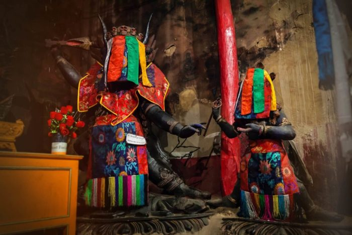 Inside the gonkhang or room with wrathful deities who are covered with brightly colored cloth