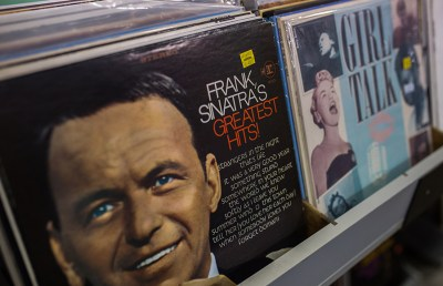 Classic and modern LPs line shelves around the store.