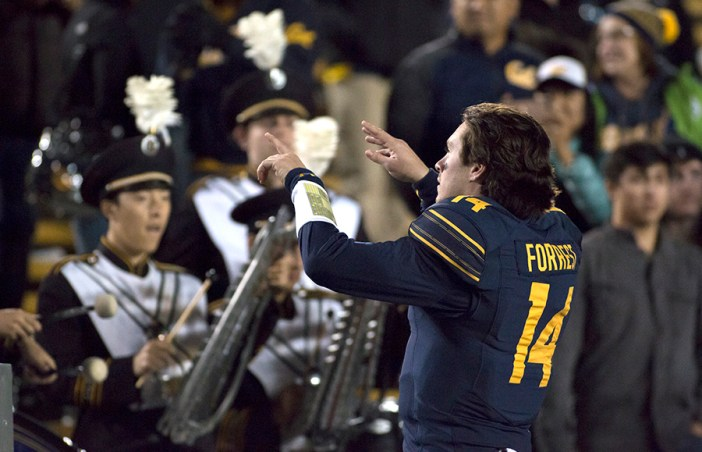 Following a Cal victory over Colorado, quarterback Chase Forrest conducts Cal Band to conclude Senior Day. KAREN CHOW/SENIOR STAFF