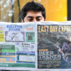 Man reads the East Bay Express.