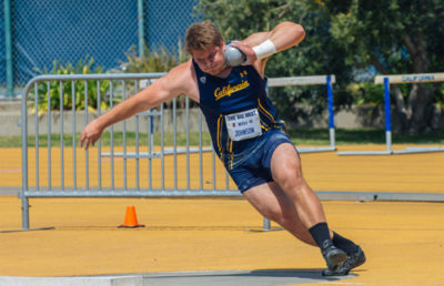 Athlete competes in track and field competition.
