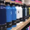 Different colors of Hydro Flasks on a shelf.