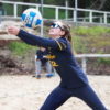 Volleyball player bumps the ball.