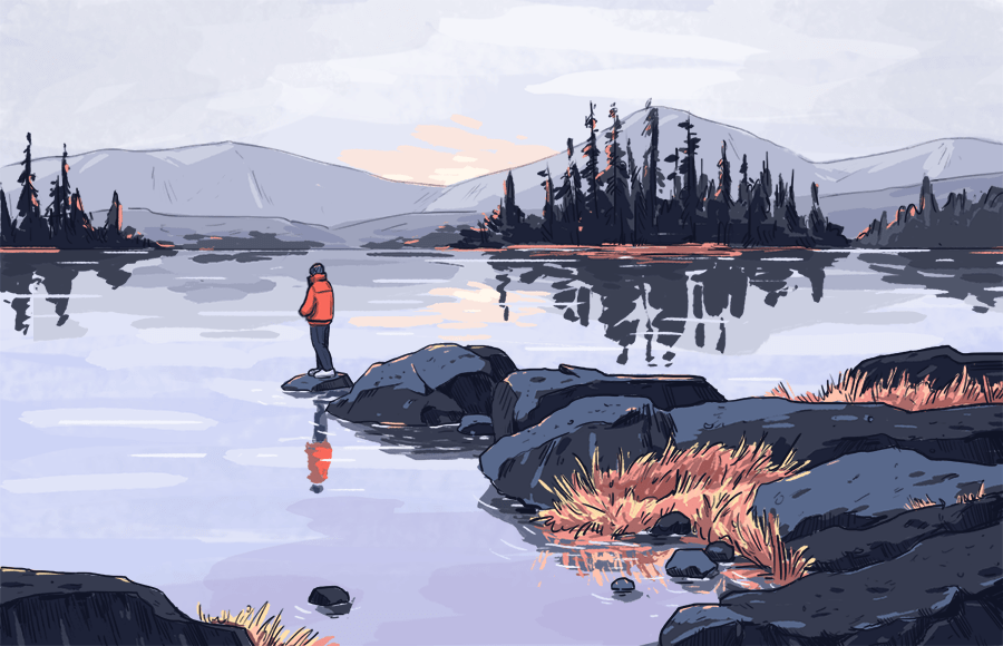 A landscape of a lake, trees, and mountains with a person standing on a rock.