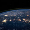 An aerial photograph of the Earth at night.