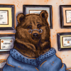 A Golden Bear sits in an office with several degrees on the wall for various languages.