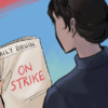 """A person reading the Daily Bruin paper which reads """"On Strike"""""""