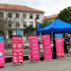 A tent set up outside Dwinelle Hall with planned parenthood signs