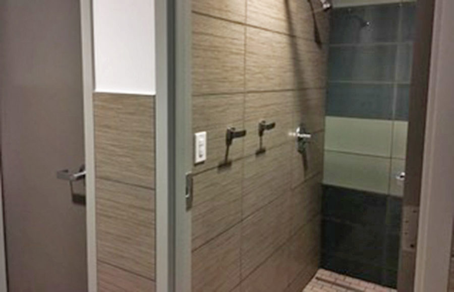 The inside of a building displays a small shower.