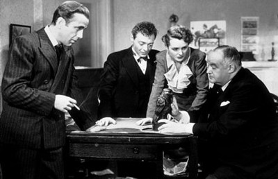"""Photo of Humphrey Bogart, Peter Lorre, Mary Astor, and Sidney Greenstreet in """"The Maltese Falcon"""""""