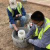UC Berkeley Environmental Health & Safety staff members Tim Pine and Al Sanchez deploy an autosampler at University Village to collect wastewater for analysis.