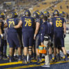 Photo of Cal Football team huddled