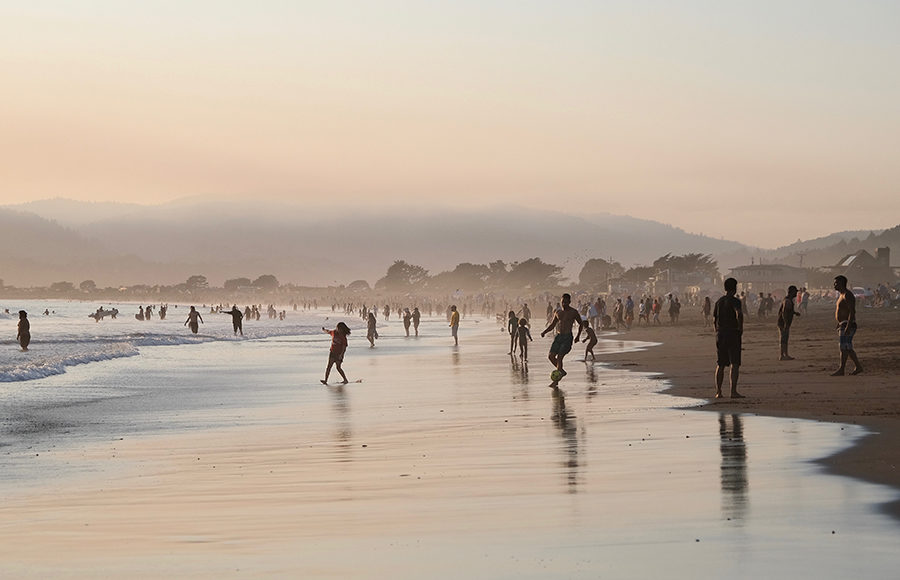 Photo of a beach with many people