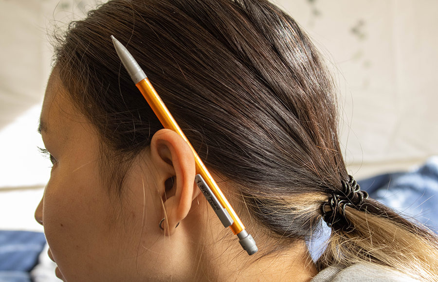 Photo of pencil resting on someone's ear