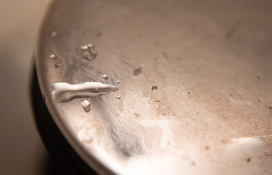 Photo of water droplets in a sink