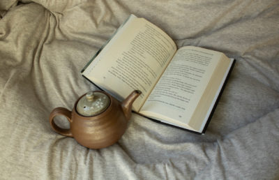 Image of teapot and book
