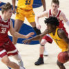 Photo of Cal Men's Basketball player, Joel Brown, dribbling against a Stanford defender