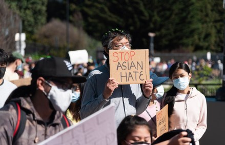 "Photo of protestor with ""Stop Asian Hate"" sign"