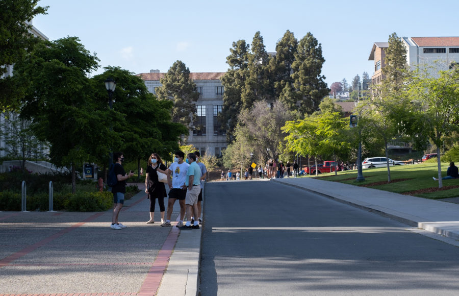 Photo of masked walkers on UC Berkeley campus