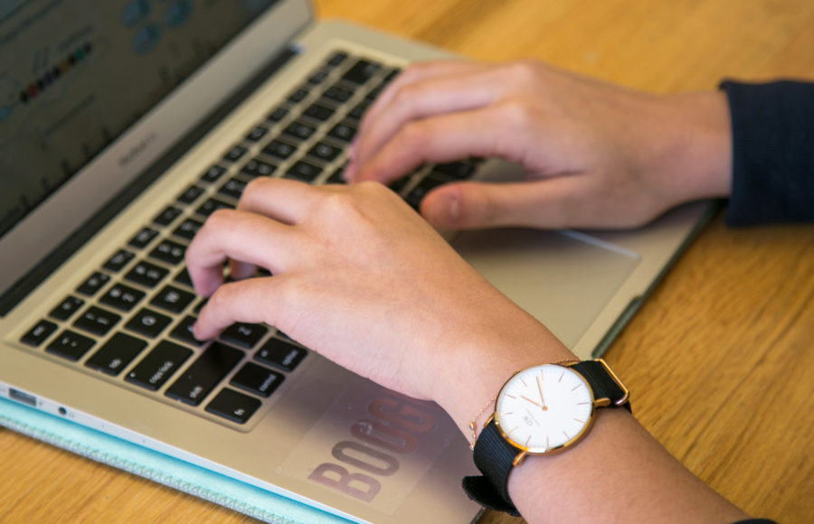 Photo of hands on a keyboard typing
