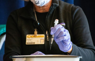 Image of woman preparing vaccine