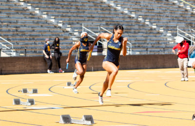 photo of two track and field athletes running