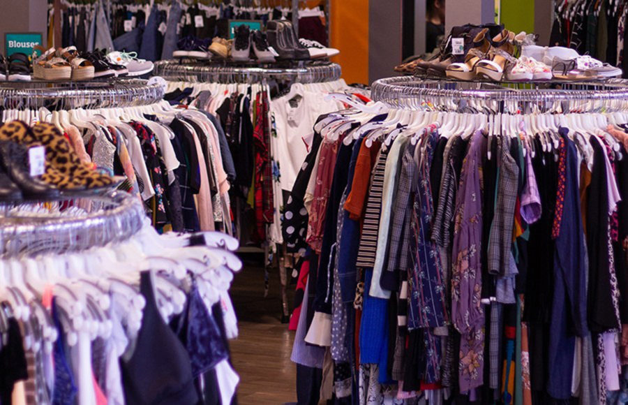 photo of clothing racks and shoes in a store
