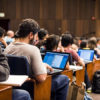 Photo of students on computers in a lecture hall