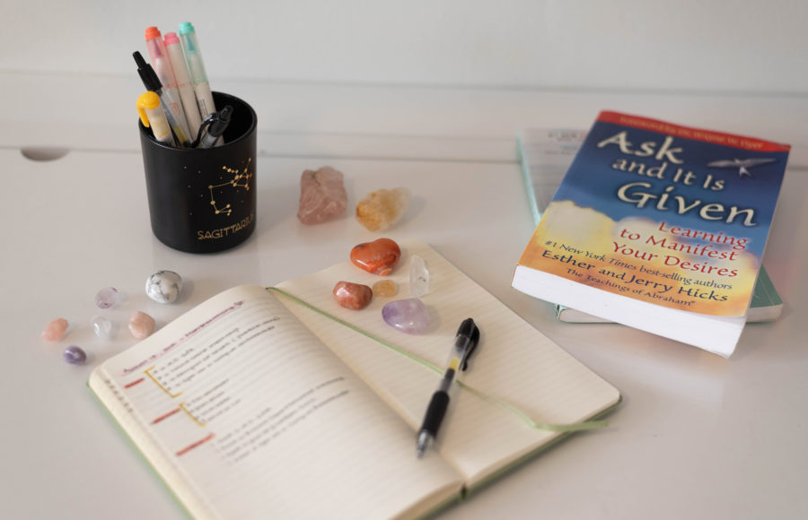 photo of a manifestation journal and book