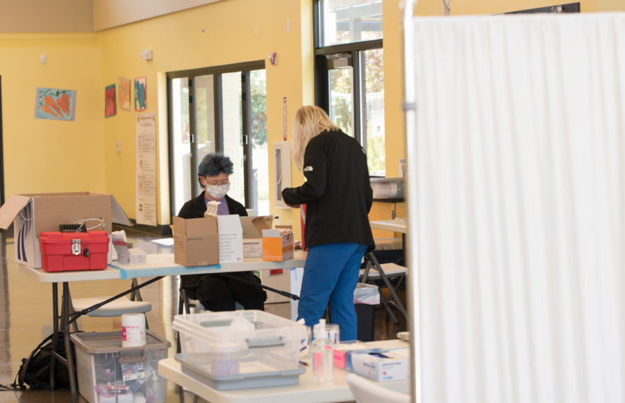 photo of 2 staffers at a vaccination center