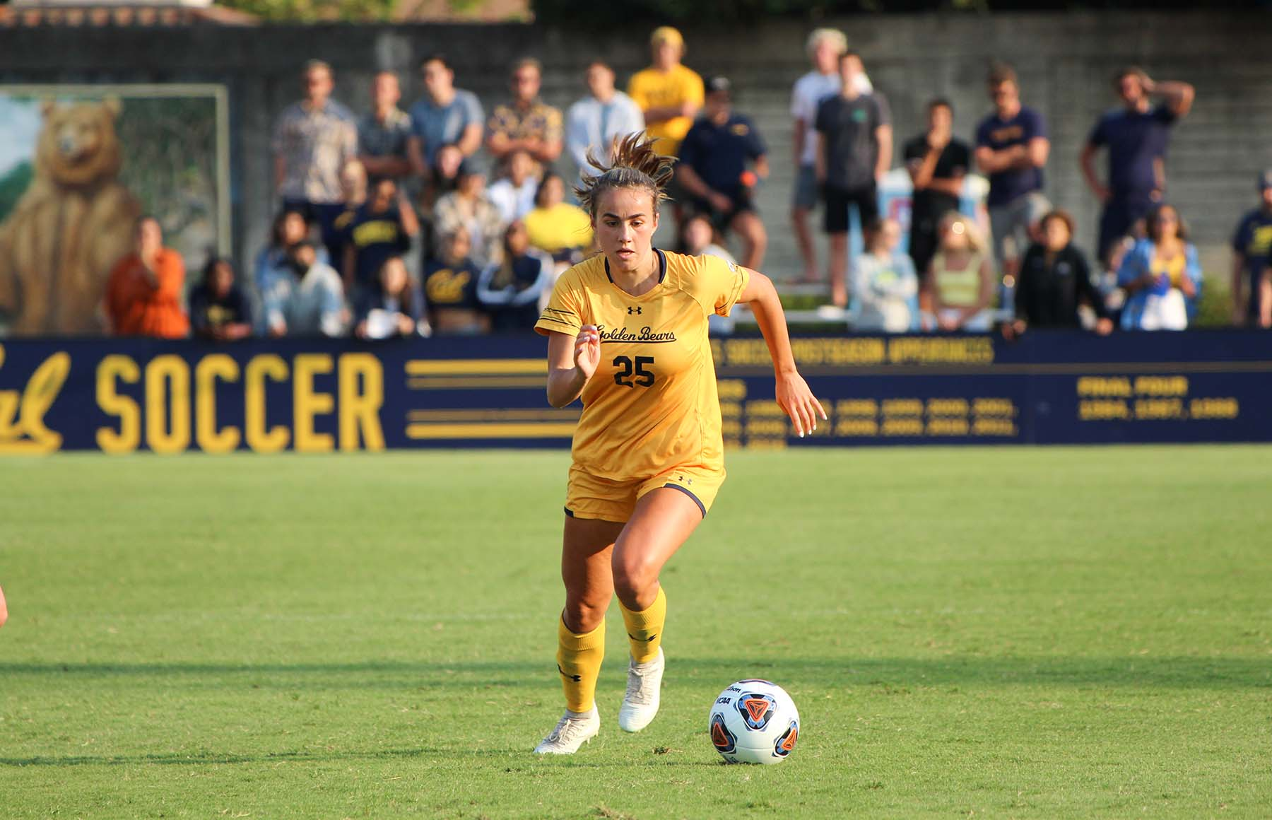 Photo of Mia Fontana from Cal Women's Soccer running for a ball