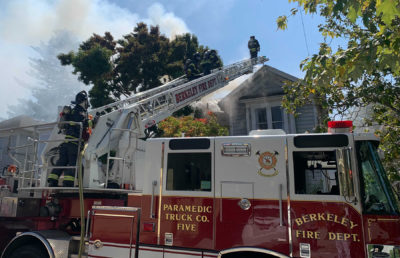 Photo of a fire truck and firefighters outside of a Berkeley home