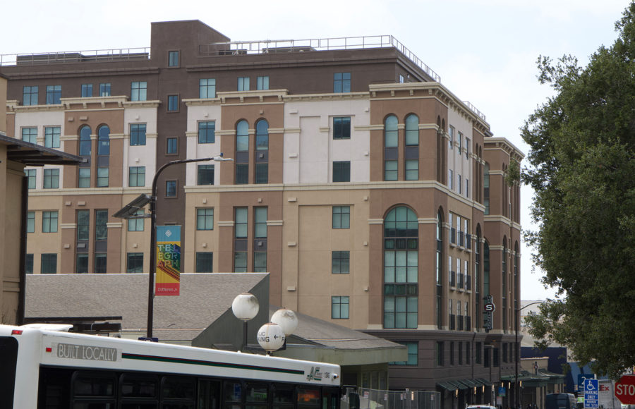 photo of apartment building by campus