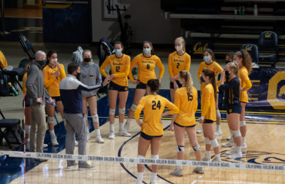photo of Cal Women's Volleyball team in a semi-huddle