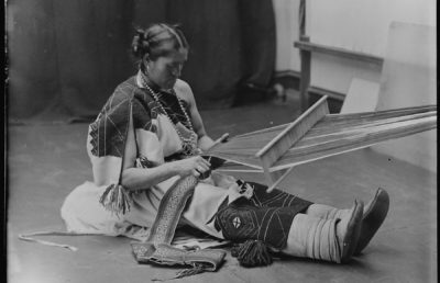 photo of an Indigenous person weaving