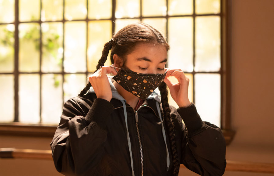 Photo of someone putting on a mask
